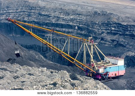 Dragline on open pit coal mine in Russia