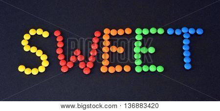 Closeup of the pile of colorful sweet bonbons with