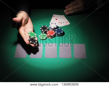 Man playing poker on green background. Casino concept