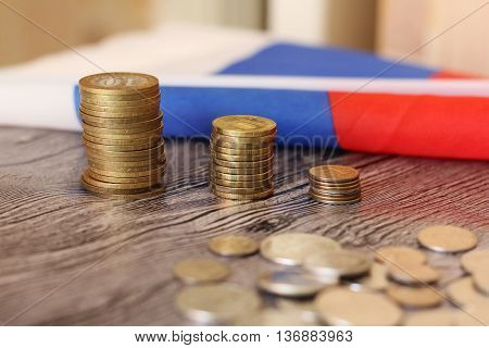 Money and the Russian flag, golden coins