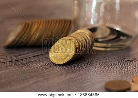 Money, golden coins and glass, russian finance
