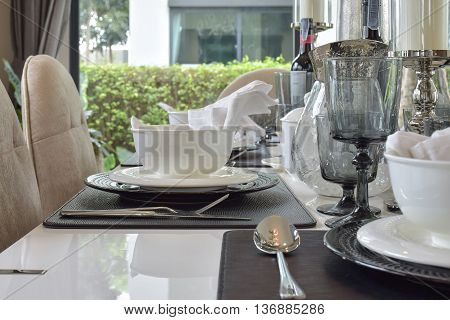 Elegant Table Set On Dining Table In Modern Style Dining Room Interior