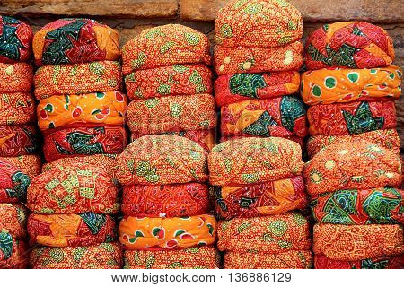 Display of neatly piled up red Rajasthani Caps near Patawon-ki-Haweli in Jaisalmer Rajasthan India Asia