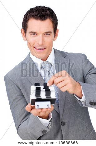 Assertive businessman searching for the index against a white background
