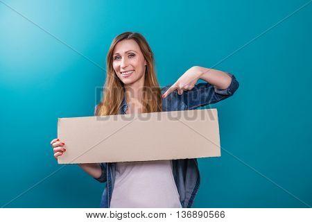 younger hipster student female finger advertise