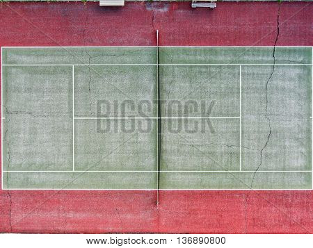 An empty and run down tennis court