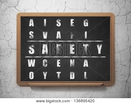 Safety concept: Painted White word Safety in solving Crossword Puzzle on School board background, 3D Rendering