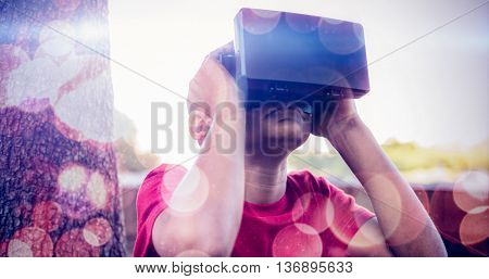 boy using a virtual reality device in the park