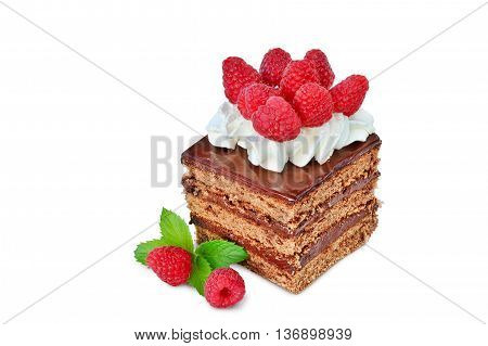 Piece of chocolate cake with whipped cream icing and raspberries isolated on white background
