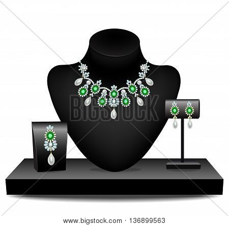 Necklaces, earrings and brooch with diamonds and emeralds on mannequins