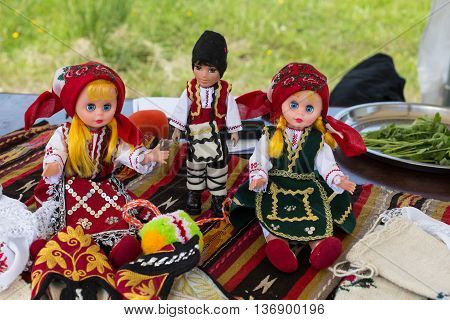 Bansko, Bulgaria - June 17, 2016: Variety of traditional bulgarian souvenir dolls in national costumes on the table