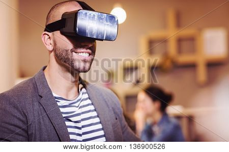 Image of a city landscape against male graphic designer wearing virtual glasses