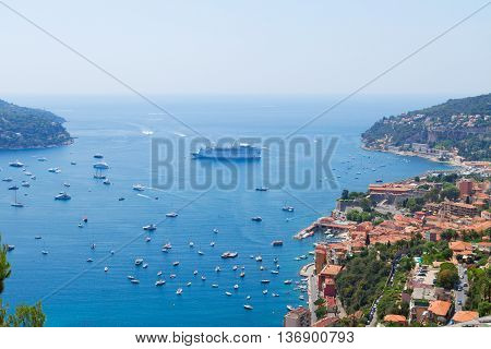 colorful coast and turquiose water with boats and ships, cote dAzur, France