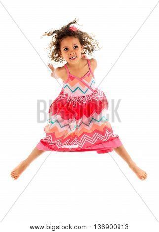 Little Girl Is Jumping In The Air, Celebrating Being Active.