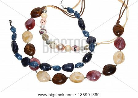 Costume jewelry. Multi-colored beads on a white background isolated.