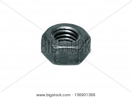 Steel nut with metric thread on white background.
