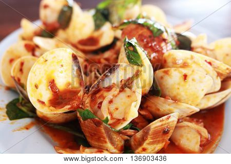Spicy stir-fried clams with basil as a side dish of meal