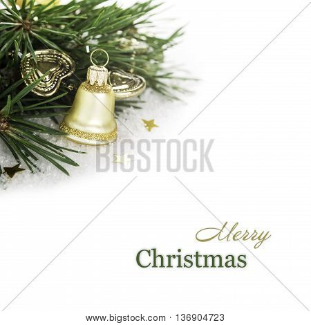 Christmas composition with golden bell and branch of christmas tree. Concept with copy space and sample text.