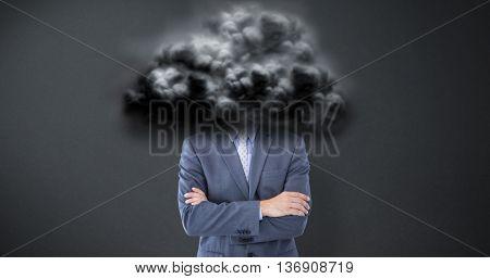 Portrait of smiling businessman standing hands folded against grey background
