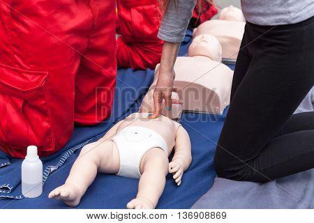 Cardiopulmonary resuscitation - CPR. Infant CPR training manikin first aid. Cardiac massage.