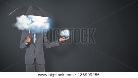 Businessman standing under umbrella against grey background