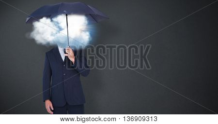 Businessman holding umbrella on white background against grey background