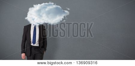 Handsome businessman leaning against grey background