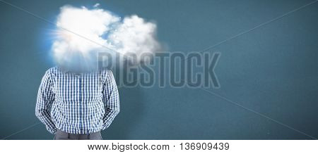 Happy businessman smiling at camera against blue background