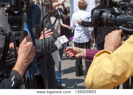 Filming an media interview with a video camera