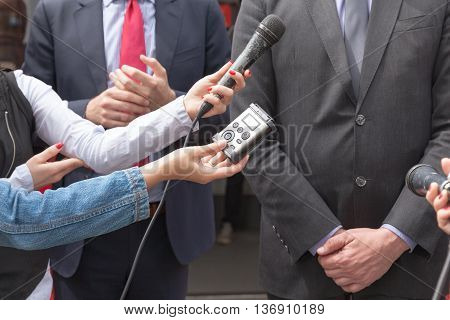 Reporters making media interview with businessman or politician