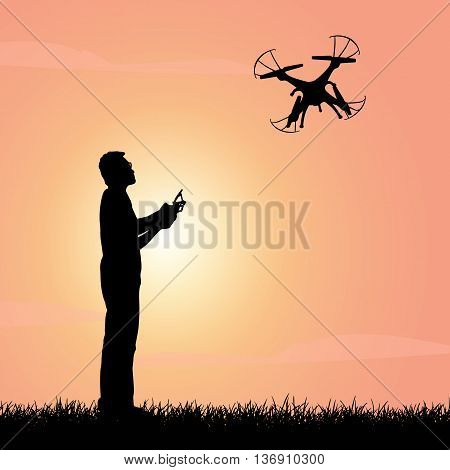 Silhouette of Happy man use drones outdoor with sunset male