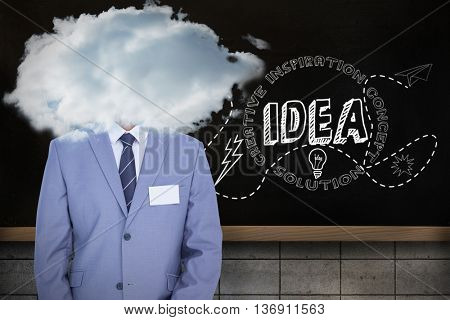 Businessman with badge against blackboard on wall