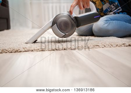 Cleaning of rug in house portable rechargeable vacuum cleaner