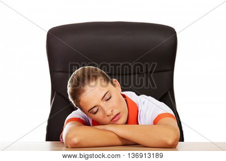 Tired young female Doctor nurse sleeping on the desk