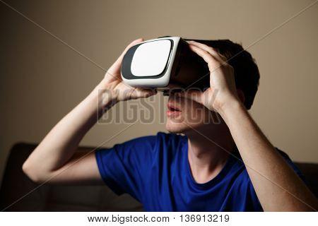 Man wearing virtual reality goggles.