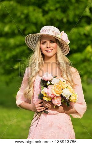 Outdoor Fashion Model Portrait Young Woman in Summer Hat Flowers Bouquet