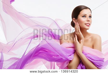Woman Face Beauty Fashion Model and Waving Fabric Silk Cloth over White