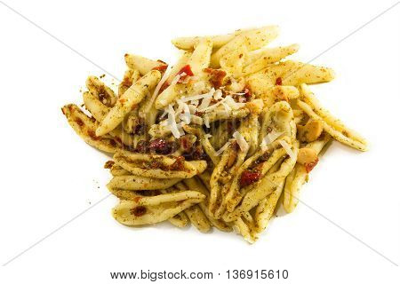 homemade pasta variety called capunti specialty from southern Italy with garlic and oil pickled tomatoes and cheese parmesan view from above isolated with shadow on a white background selective focus