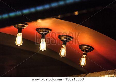 Retro Tungsten Lamps Glowing In Dark Interior