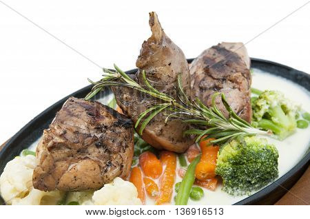 roasted rabbit meat and potatoes with vegetables