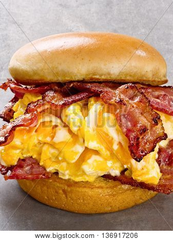 close up of rustic american bacon egg and cheese sandwich
