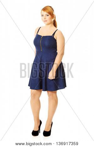 Plus size woman posing in skirt