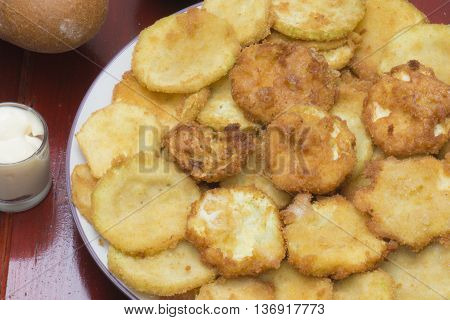 Zucchini, fried in batter, on the table