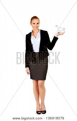 Attractive business woman holding small trolley