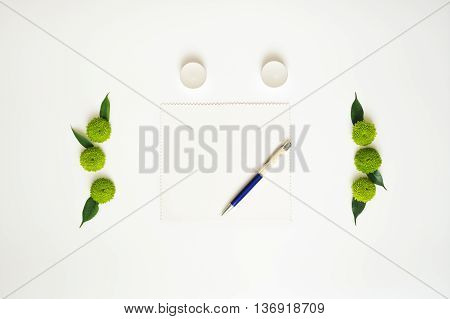 Paper, Pen And Candles With Decoration.