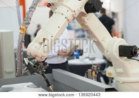 Industrial robot arm. Robotic arm for welding.