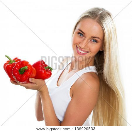 Happy young woman with red pepper