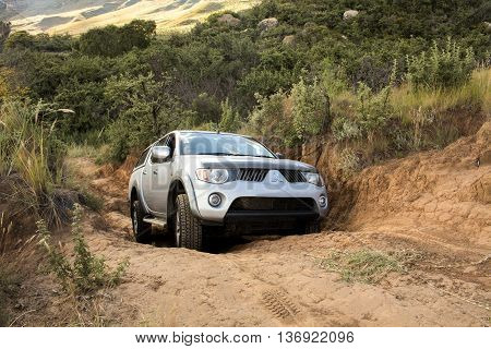 Golden Gate Highlands National Park, South Africa - April 30 2016: The car Mitsubishi Triton is doing off-road trail.