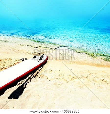 Holiday beach sunny seascape with surf desk sand and ocean. Summer vacation concept