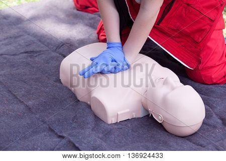 CPR dummy first aid training. Cardiopulmonary resuscitation - CPR. Cardiac massage.